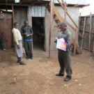 Douglas Namale maps a school in Kibera for Map Kibera's Open Schools Kenya project