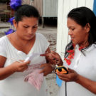 Indigenous women from the river Cuieiras, community Manaus, learning how to register coordinates with GPS equipment